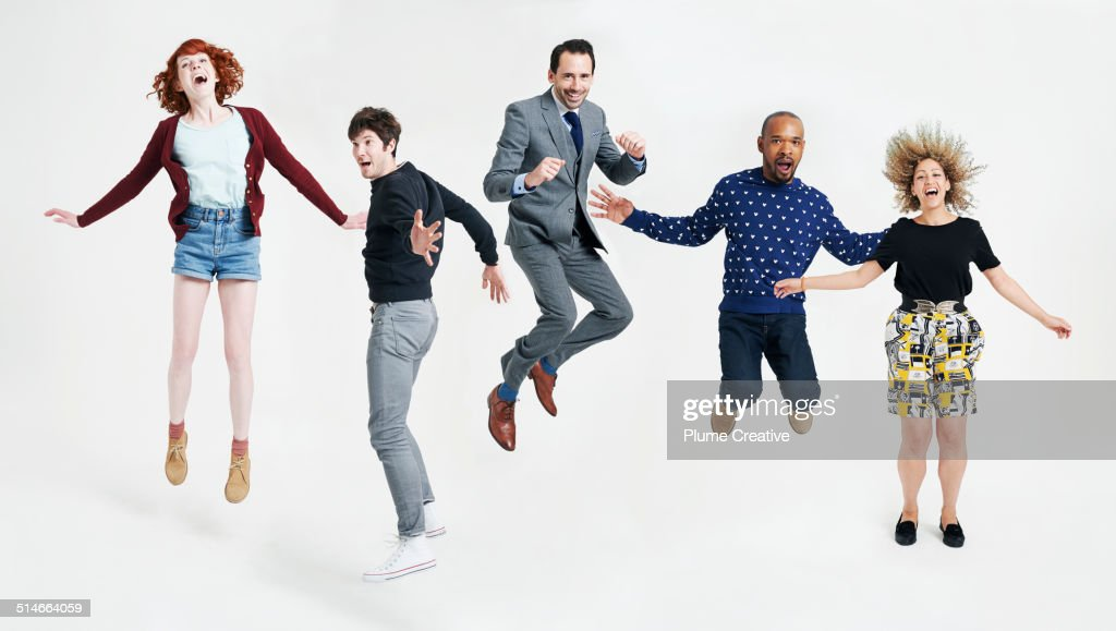 A group of people jumping in the air : Stock Photo