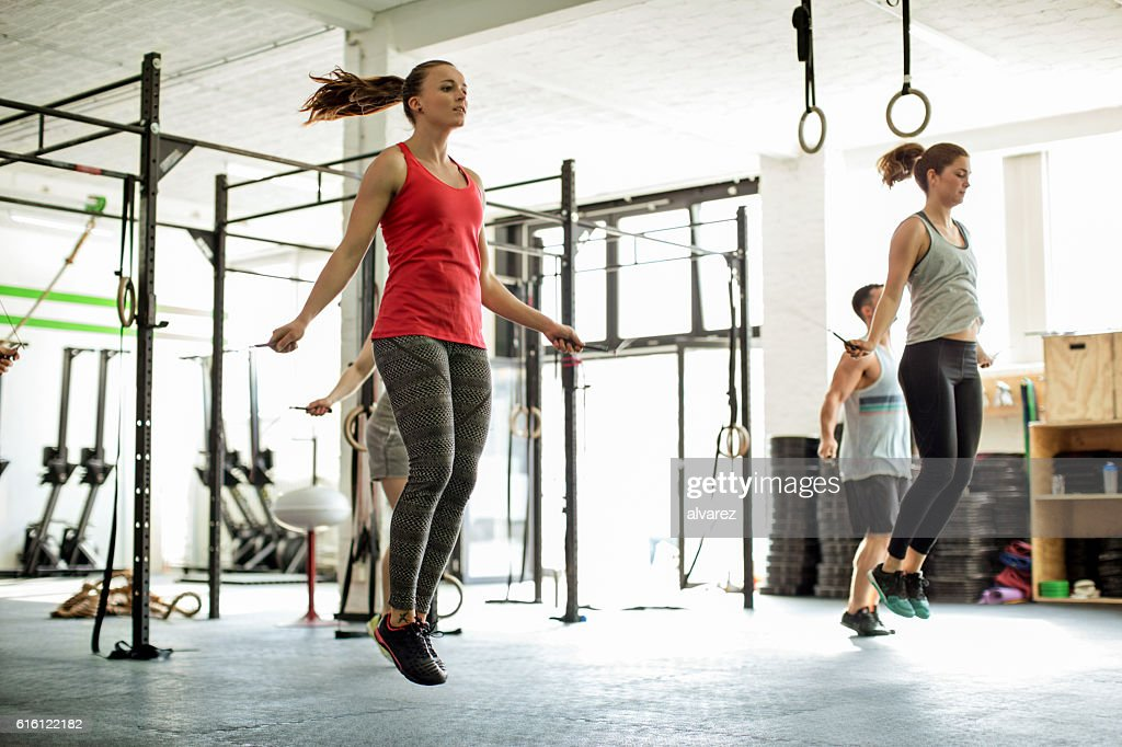 Group of people jumping rope in a fitness class : Stock Photo