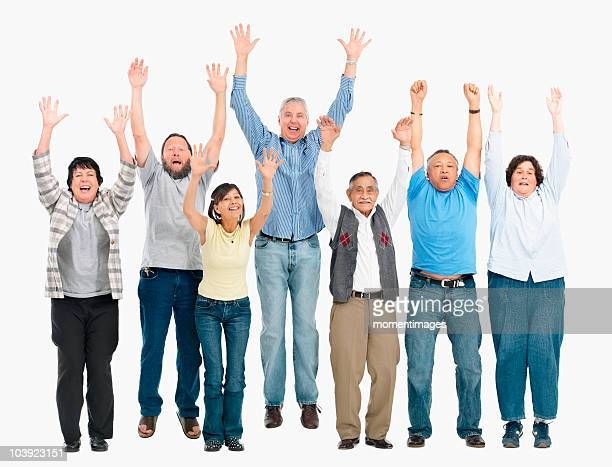 A group of people jumping with their arms raised