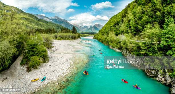 group of people kayaking on the river soča in slovenia europe - slovenia foto e immagini stock