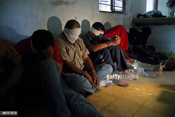 A group of people kidnapped by alleged drugtraffickers sit on the floor after being rescued by members of the Mexican Army in Sabinas Hidalgo 99 km...
