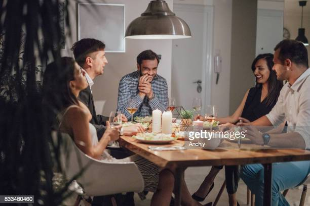group of people laughing to a funny joke that one of them told - dining room stock pictures, royalty-free photos & images