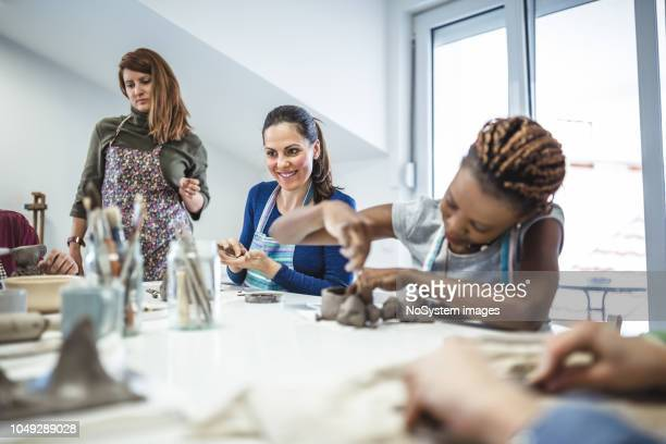 group of people learning ceramic art. - carving craft product stock pictures, royalty-free photos & images