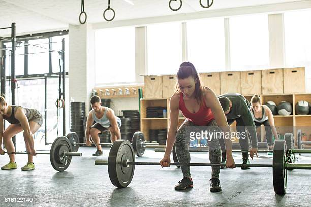 Group of people lifting weights at fitness class
