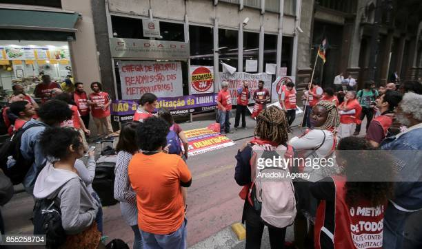 A group of people linked to the Subway Workers' Union stage a demonstration against employee layoffs and the expansion of the privatization of subway...
