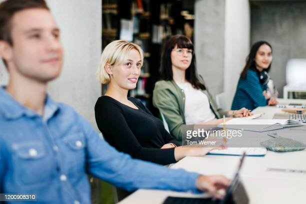 group of people listening during seminar in library - 教育 ストックフォトと画像