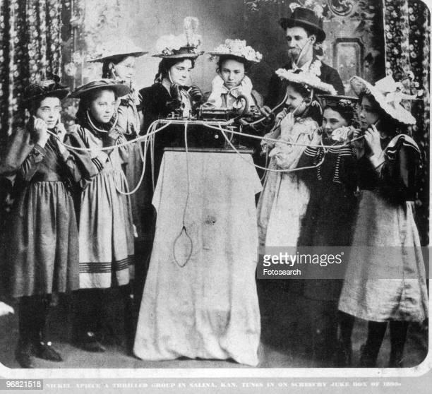 Group of People Listening to a Jukebox in Salina Kansas circa 1890