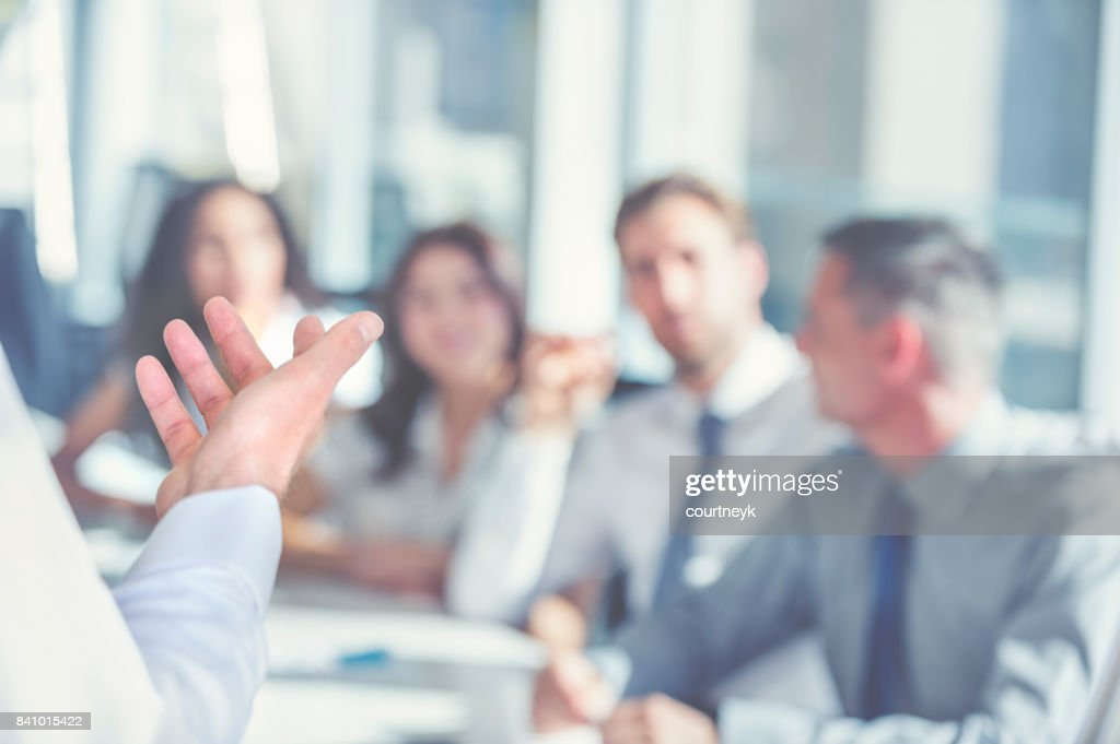 Group of people listening to a presentation. : Stock Photo