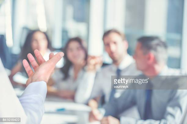 Group of people listening to a presentation.