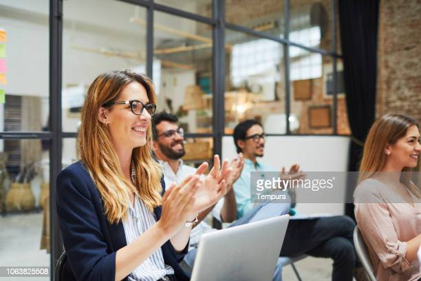 group of people listening to a presentation speech. - millennial generation stock pictures, royalty-free photos & images
