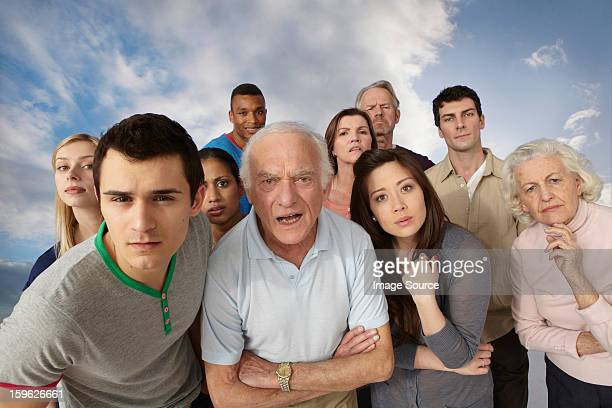 group of people looking angrily at camera - staring stock photos and pictures