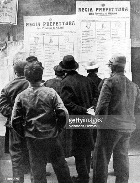 A group of people looking at election posters in the Province of Milan ahead of general elections in November Lombardy 1919