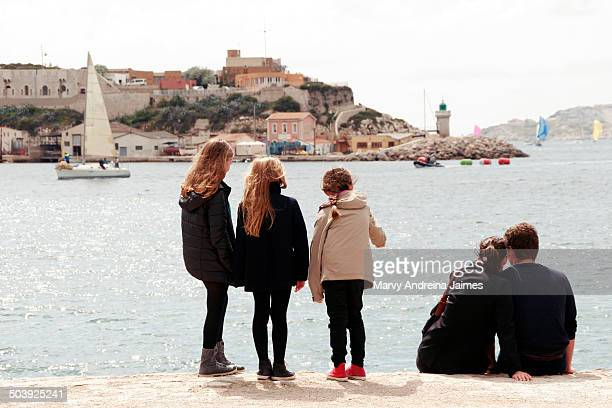 Group of people looking at the sea on a pier