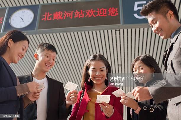 Group of people looking at tickets at the railway station