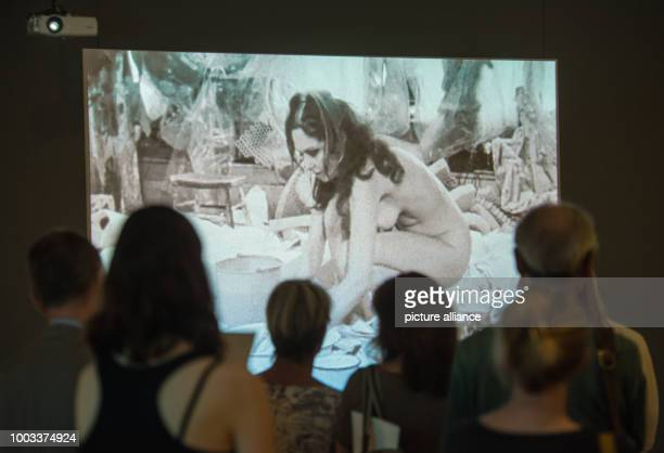 A group of people looks at the artwork 'Body Collage' by Carolee Schneemann from 1967 at the exhibition 'Carolee Schneemann Kinetische Malerei' in...