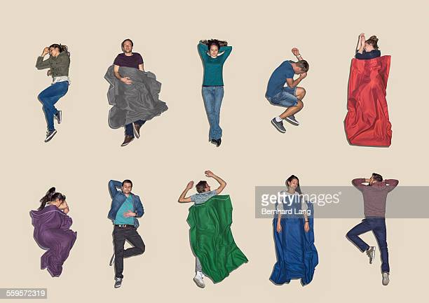 group of people lying down sleeping, aerial view - lying down foto e immagini stock