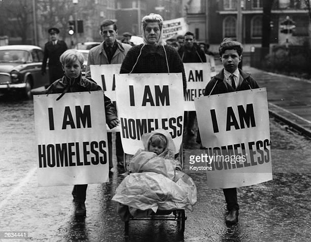A group of people march to the home of the Minister of Housing Sir Keith Joseph to call for the requisitioning of some of London's empty houses