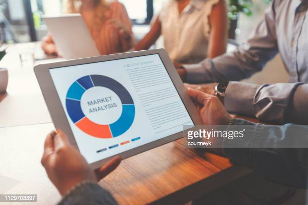 group of people meeting with technology. - computer monitor stock pictures, royalty-free photos & images