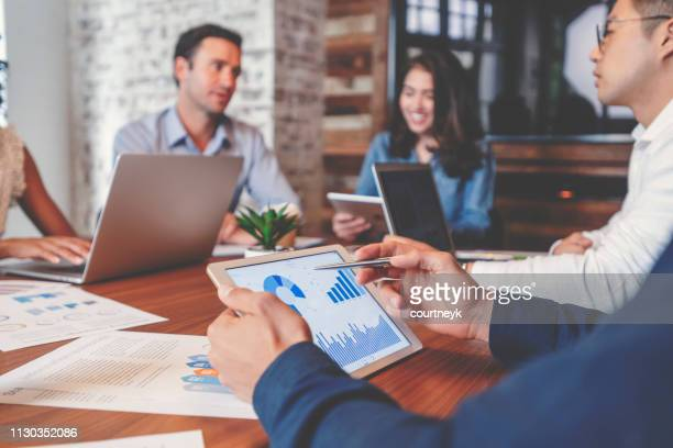 group of people meeting with technology. - finanza foto e immagini stock