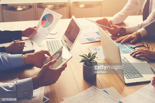 group of people meeting with technology. - business strategy stock pictures, royalty-free photos & images