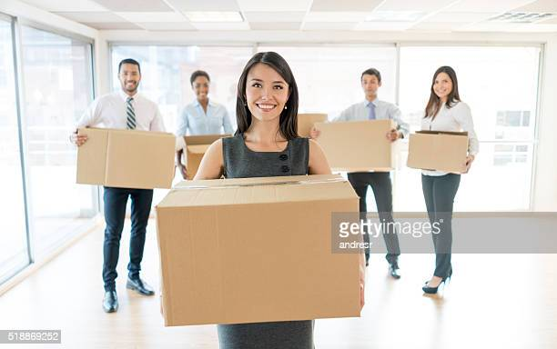 Group of people moving to a new office