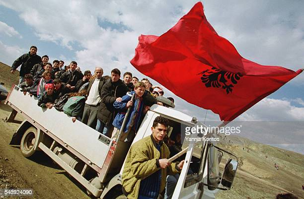 A group of people of Albanian origin in the back of a truck flying an Albanian flag | Location Likosane Federal Republic of Yugoslavia