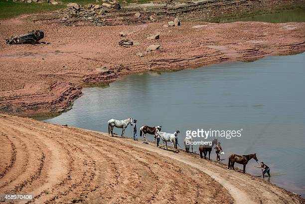 A group of people on a church pilgrimage water their horses at the Jaguari Reservoir near Sao Jose dos Campos in the state of Sao Paulo Brazil on...