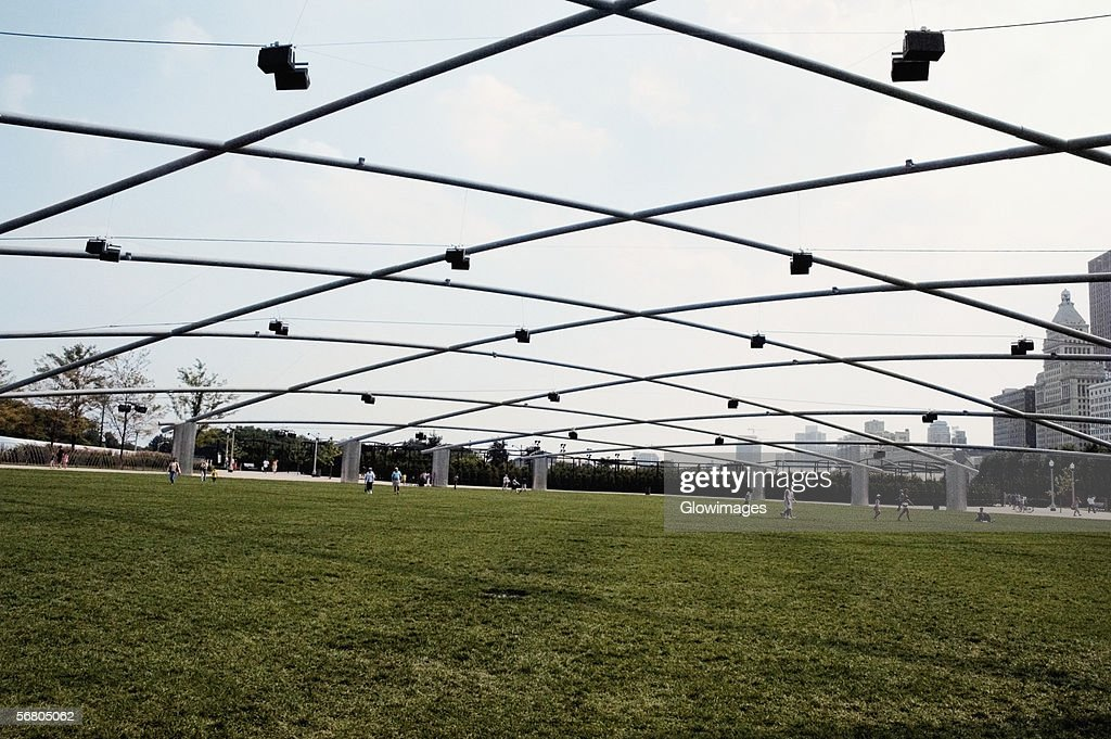 Group of people on a lawn, Great Lawn, Jay Pritzker Pavilion, Chicago, Illinois, USA : Stock Photo