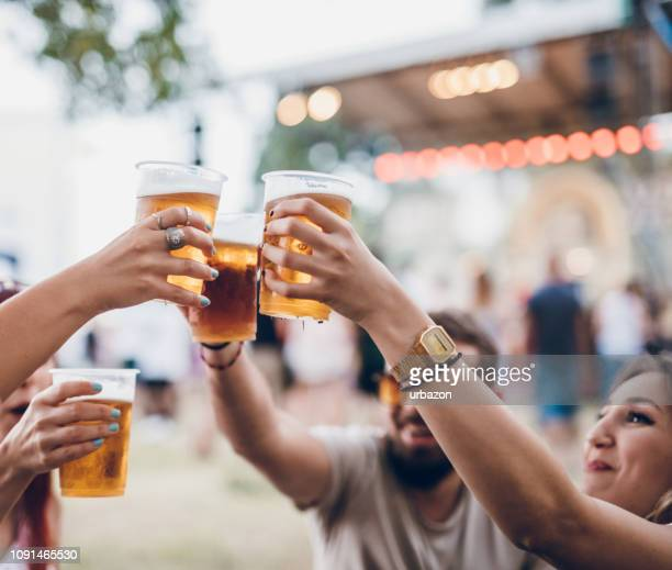 group of people on a music festival - beer stock pictures, royalty-free photos & images