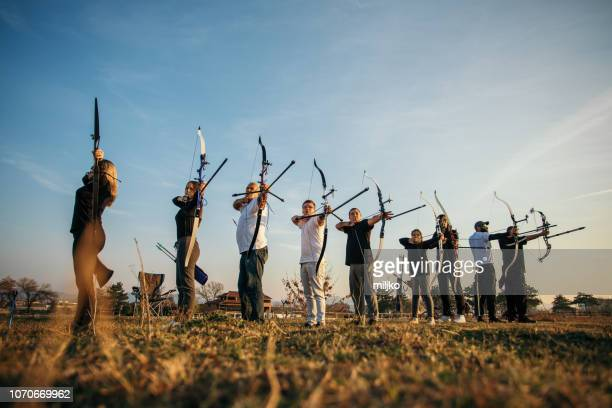 group of people on archery training - participant stock pictures, royalty-free photos & images