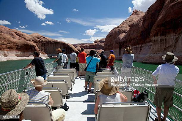 group of people on boat on lake - timothy hearsum stock pictures, royalty-free photos & images