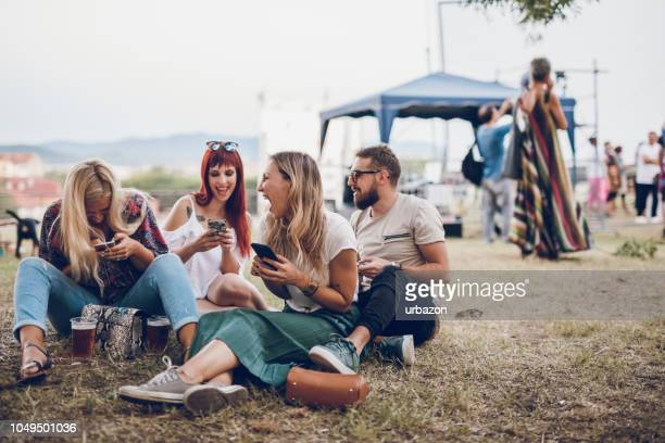 group of people on music festival - music festival stock pictures, royalty-free photos & images
