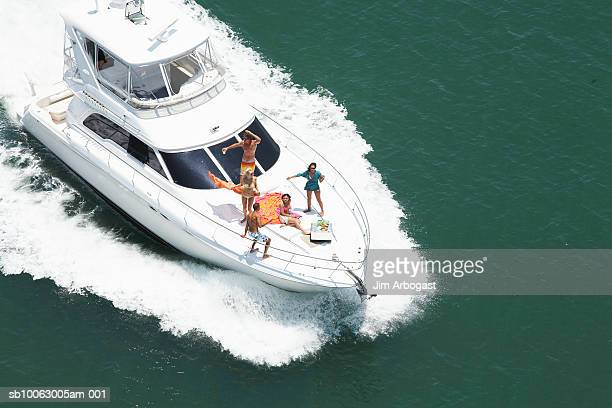 Group of people on speedboat at sea, aerial view