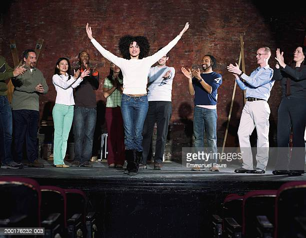 group of people on stage in theater applauding actor - actor stock pictures, royalty-free photos & images