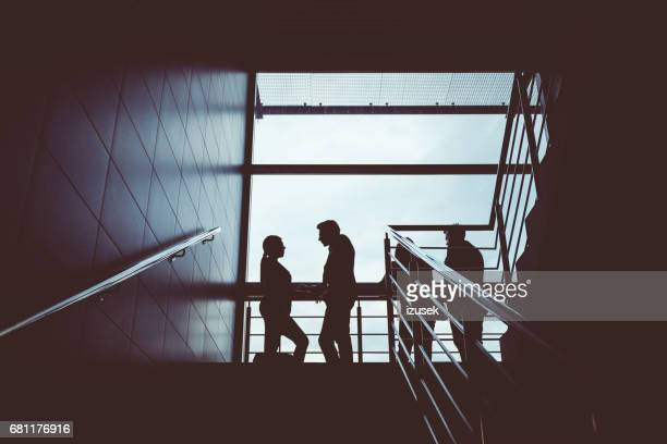 group of people on steps in airport - izusek stock pictures, royalty-free photos & images