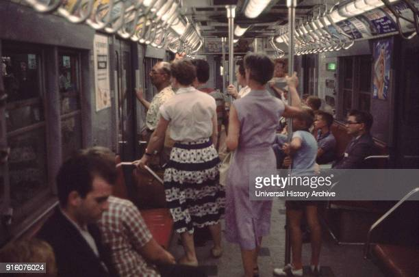 Group of People on Subway New York City New York USA July 1961