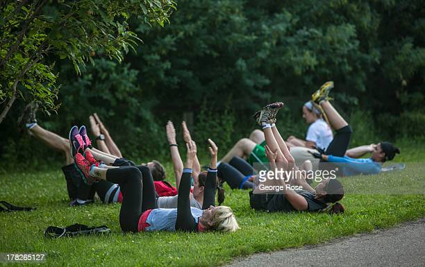 A group of people particpate in a militarystyle physical workout along the Saskatchewan River near downtown on July 1 2013 in Edmonton Alberta Canada...