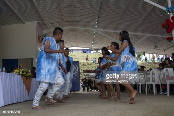 A group of people perform during a ceremony for 120 exFarc fighters mostly indigenous and members of the Nasa community who completed their training...