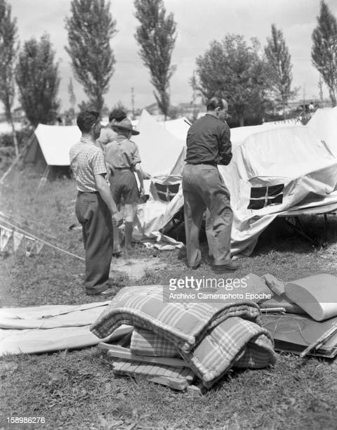 A group of people pitch tents at a campsite Padova Italy 1950