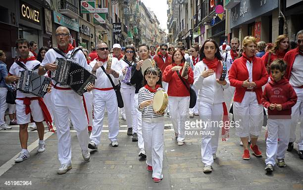 A group of people play accordions and tambourines along Estafeta street during the San Fermin Festival in Pamplona northern Spain on July 10 2014 The...
