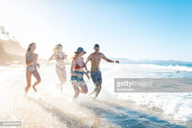 Group of people playing at the beach