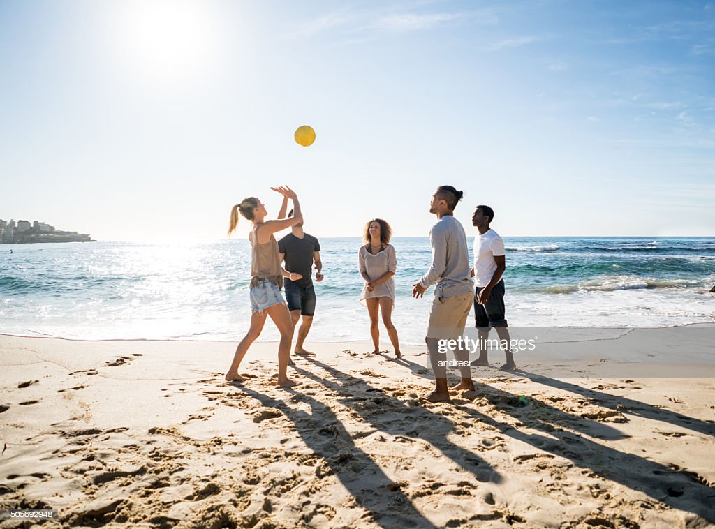 Group of people playing beach volleyball : Stock Photo