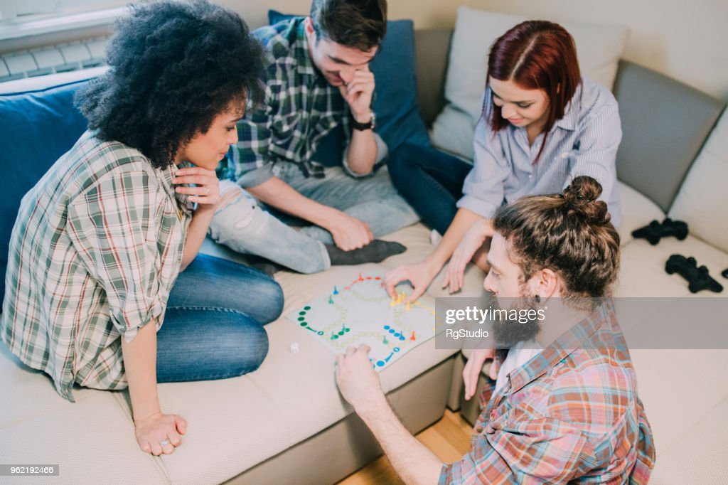 Group of people playing board games : Stock Photo