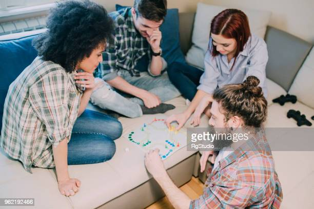 Group of people playing board games