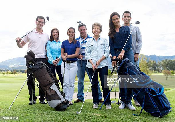 Group of people playing golf