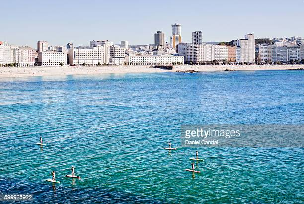 Group of people playing paddle surf in A Coruña bay, Galicia (Spain)