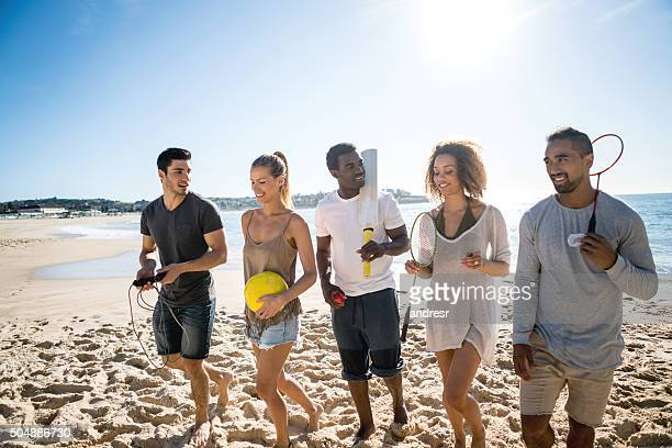 group of people playing sports - beach cricket stock pictures, royalty-free photos & images