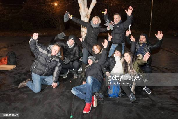 A group of people pose in the sleeping outdoor area of Sleep In The Park a Mass Sleepout organised by Scottish social enterprise Social Bite to end...
