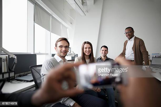 Group of people posing for smart phone photo
