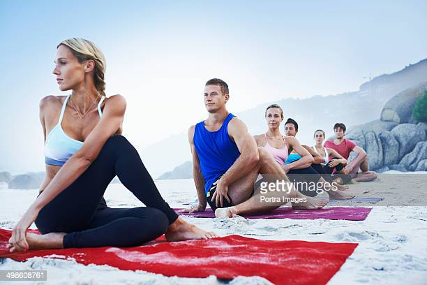 Group of people practising yoga outside